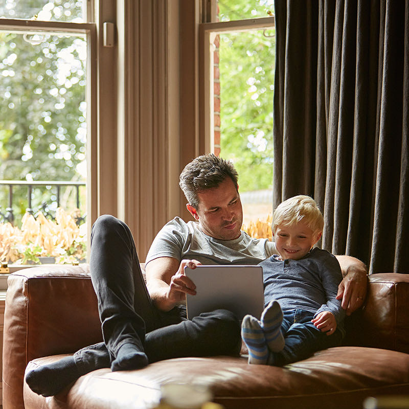 Man and son looking at tablet
