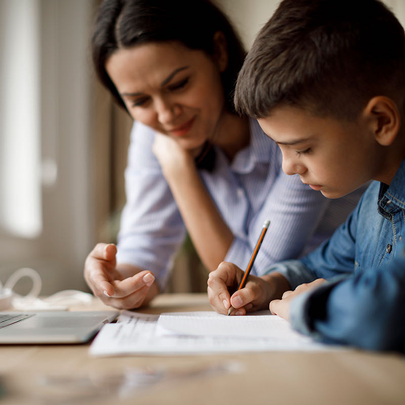 Mom helping son with homework